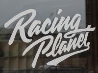 Shop Racing Planet Scooter Branded Merchandise and Decals - Sticker sticker Racing Planet 200x115mm in white
